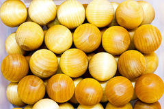 Wooden balls. Bunch of small and yellow wooden balls Royalty Free Stock Photo