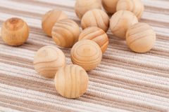 Wooden balls. On beige fabric background Stock Images