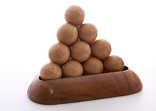 Wooden Balls triangle. Wooden balls puzzle assembled on white background Stock Photography