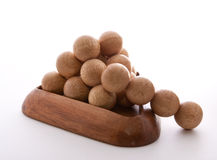 Wooden Balls triangle. Disassembled Wooden balls puzzle on white background Royalty Free Stock Images