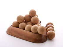 Wooden Balls triangle. Disassembled Wooden balls puzzle on white background Stock Photography