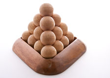 Wooden Balls triangle. Wooden balls puzzle assembled on white background Stock Images
