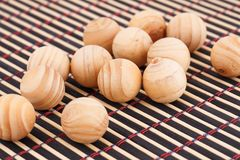 Wooden balls. On bamboo background Stock Image
