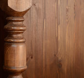 Wooden baluster. Carved baluster on a wooden background Royalty Free Stock Photo