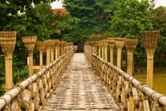 Wooden Bamboo bridge. Wood bamboo bridge for walk to cross a river royalty free stock images