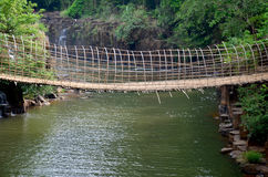 Wooden with bamboo bridge for cross over stream river from Tad P Stock Images