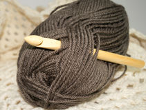 Wooden bamboo crochet hook in bundle of  yarn Royalty Free Stock Images