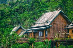 A wooden bamboo house in a rainforest. Sanya Li and Miao Village stock images