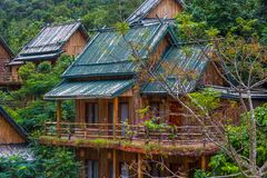 Wooden bamboo houses in the jungle. Sanya Li and Miao Village. H Royalty Free Stock Photos