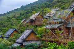 Wooden bamboo houses in the jungle. Sanya Li and Miao Village. H royalty free stock photography