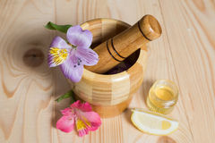 Wooden bamboo pounder with flowers. And honey Stock Photography