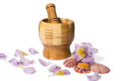Wooden bamboo pounder with flowers. And petals Royalty Free Stock Photos