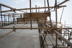 Wooden with bamboo scaffolding Stock Image