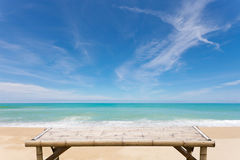 Wooden bamboo sunbeds on beautiful beach and sea scenery backgro Stock Image
