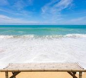 Wooden bamboo sunbeds on beautiful beach and sea scenery backgro Royalty Free Stock Photography