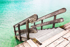 Wooden banister of the pier Stock Photography