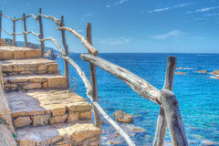 Wooden banister by the sea Stock Photo