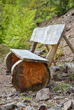 Wooden bank in the forest. Wooden bank along a path in the forest stock photo