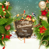 Wooden banner with Christmas Fir-tree branches. Royalty Free Stock Photos
