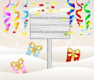 Wooden banner and christmas gifts Stock Image