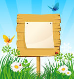 Wooden banner in the grass Royalty Free Stock Photo