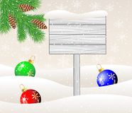 Wooden banner, green branches with cones and christmas toys ball Royalty Free Stock Photography