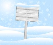 Wooden banner stands on to snow Royalty Free Stock Photography