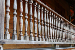Wooden bannister of the balcony Royalty Free Stock Photo