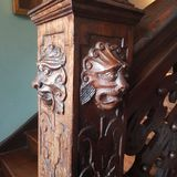 Wooden bannister. Carved lion on wooden bannister royalty free stock photo