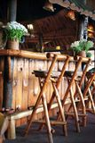 Wooden bar. And chairs in small restaurant Stock Images