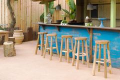 Wooden bar with bar stools. Traditional wooden bar with bar stools royalty free stock photography