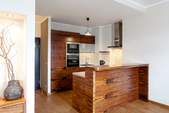 Wooden bar in kitchen. Horizontal view of a wooden bar in kitchen stock photography