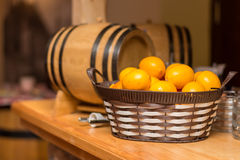 Wooden bar in a pub with a lemons in basket Stock Photos