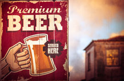 Wooden bar sign. Wooden sign above pub indicating that beer is served here stock images