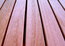 Wooden bar texture. Bars of a wooden table, focus on top of the picture Stock Photography