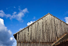 Wooden Barn. Against a background of blue skies Stock Photos
