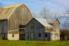 Wooden Barn. A weathered and gray wooden barn and shed on a fall day Royalty Free Stock Photos