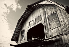 Wooden Barn - Black and White. Structure of an old Wooden Barn against  skies in autumn. Black and White image Stock Photo