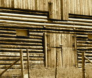 Wooden Barn With Closed Door In Sepia Stock Images