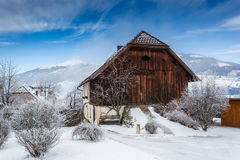 Wooden barn covered by snow in Austrian Alps Royalty Free Stock Photos