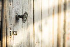 Wooden barn door in sunlight Stock Photos