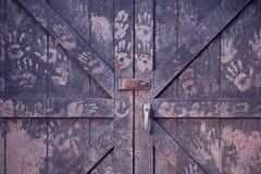 Wooden barn doors with handprints stock photography