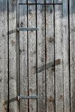 Wooden barn doors with metal hinges royalty free stock photo