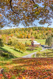 Wooden barn in fall foliage landscape in Vermont countryside Royalty Free Stock Images