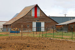 Wooden barn. Field and barn in the Utah countryside, USA Stock Photo