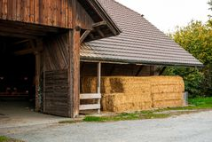 Wooden barn with hay. Autumn. The harvest. Royalty Free Stock Photo