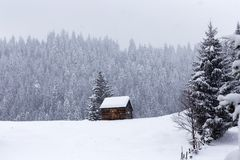 Wooden barn on Romanian mountains at winter Royalty Free Stock Images