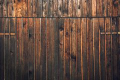 Wooden barn shed door. As background or texture, typical traditional Alpine farm gate located in Slovenian touristic village Ribcev laz, next to the Bohinj lake Royalty Free Stock Photography
