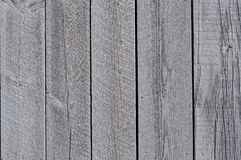 Wooden Barn Texture. Stained wooden boards that make up part of the wall of a barn Stock Image