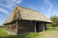 Wooden barn with thatched roof Stock Photos